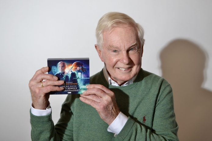 Derek Jacobi with his copy of Anti-Genesis