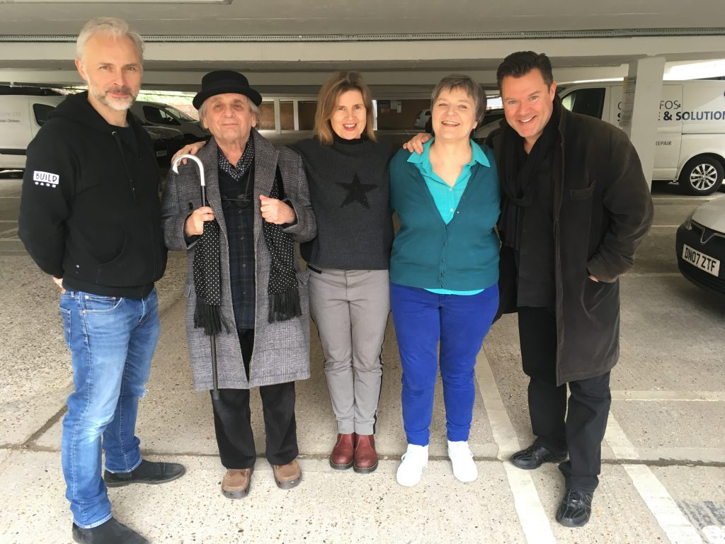 Mark Bonnar, Sylvester McCoy, Sophie Aldred, Lin Sagovsky and Glen McCready in a grey concrete car park rather than a lush rainforest.